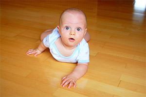 Baby Crawling on a clean timber floor