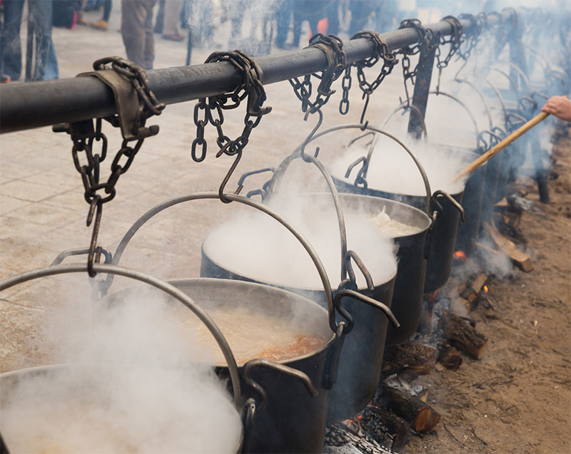 Cooking In Iron Cauldrons On Open Fire
