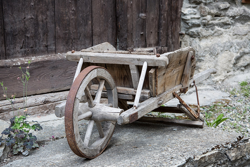 Ancient Wooden Wheel Barrow