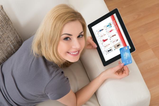 Girl Online Shopping using Tablet